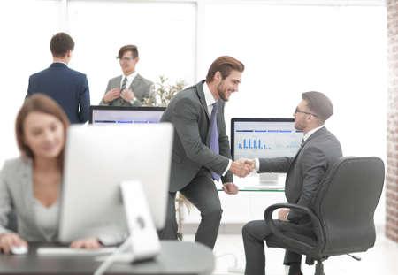 Firm handshake between two business partners