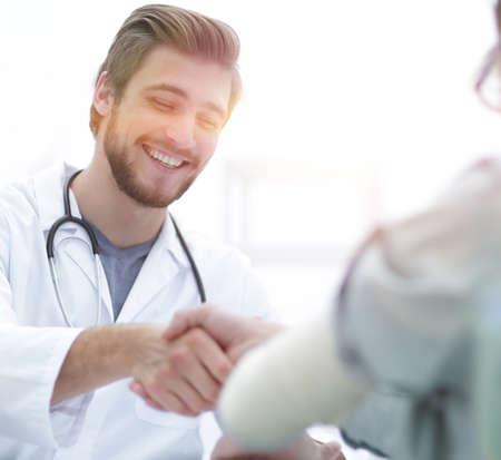 Doctor welcoming a patient in his studio