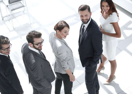 Photo pour rear view.a group of successful business people standing in the - image libre de droit