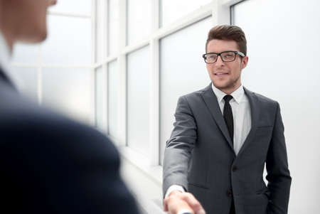 Photo for Manager greets the client with a handshake. - Royalty Free Image