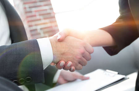 Photo for Close-up of two business people shaking hands - Royalty Free Image