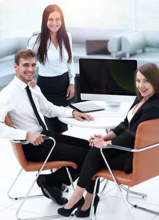 Photo pour portrait of successful business team near the desktop - image libre de droit