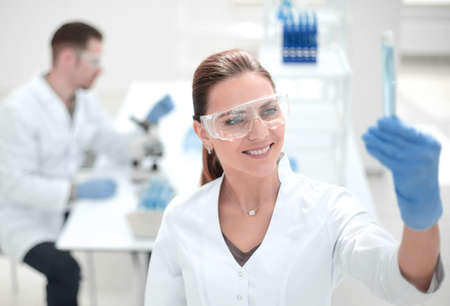 smiling female scientist standing in the lab