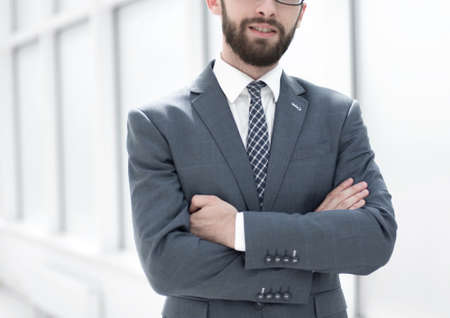 close up.handsome businessman standing in the office