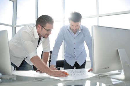 Photo pour Two Architect working with blueprints for architectural plan. - image libre de droit