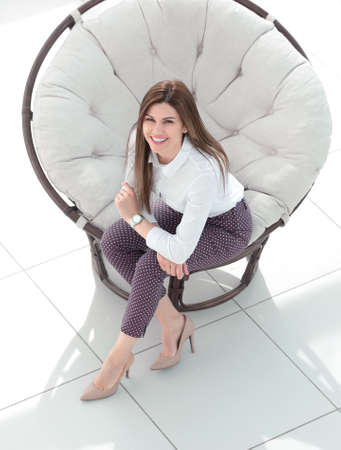 Photo pour top view.young woman sitting in soft round chair - image libre de droit