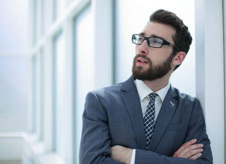 close up.pensive businessman standing in the office