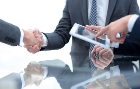 Photo for Two confident businessmen shaking hands during a meeting in the - Royalty Free Image