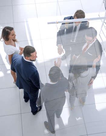 Photo pour top view. colleagues giving each other a high five - image libre de droit