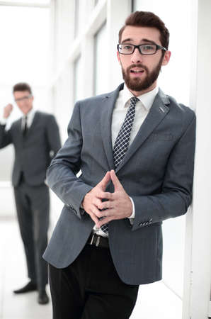 close up.smiling businessman standing in the office
