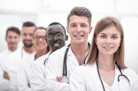 Photo pour portrait of a doctors team standing in line - image libre de droit