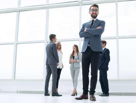 Foto de bottom view.successful businessman standing in a bright office. - Imagen libre de derechos