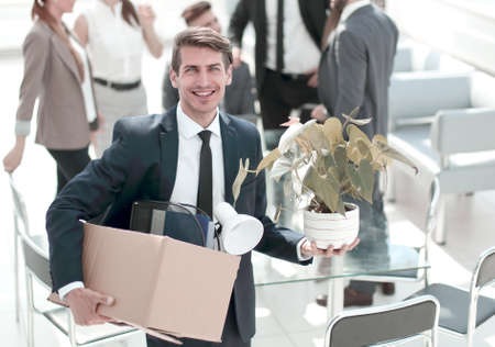 Photo for young employee standing in office on his first day - Royalty Free Image
