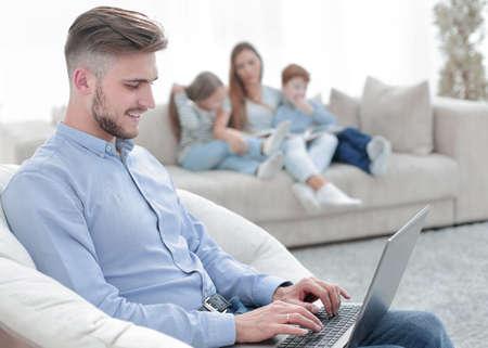 Photo pour modern man working laptop in his living room - image libre de droit