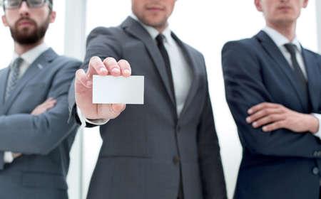 Photo pour business team leader showing business card - image libre de droit
