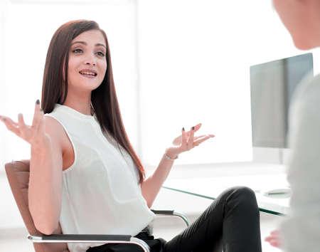 Photo pour two business women talking in the workplace - image libre de droit