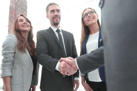Photo for businessmen shaking hands in conference room - Royalty Free Image