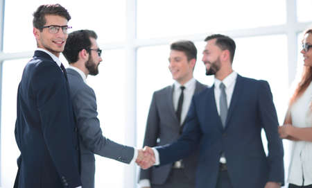 Photo pour handshake of business partners after signing the contract. - image libre de droit