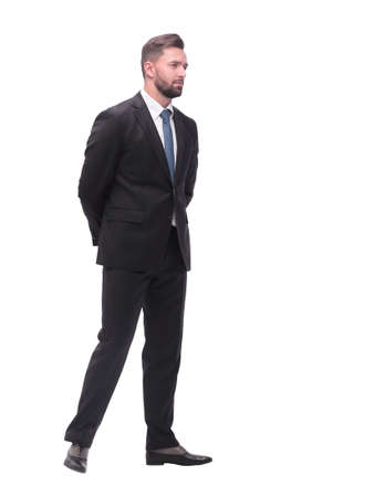 Photo for rear view. pensive businessman stepping forward . isolated on white - Royalty Free Image