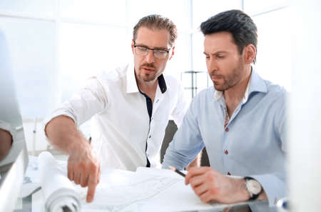 Photo pour two architects discussing the project in the office - image libre de droit