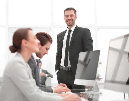 Photo pour businessman standing in his office - image libre de droit