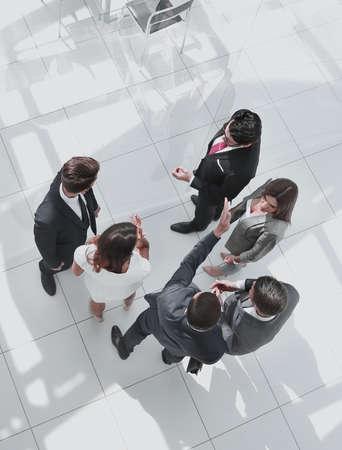 Photo pour top view. employees discussing work issues - image libre de droit