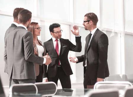Photo pour employees talking standing in the office - image libre de droit