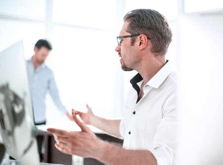 Photo pour businessman talking while sitting at his Desk - image libre de droit