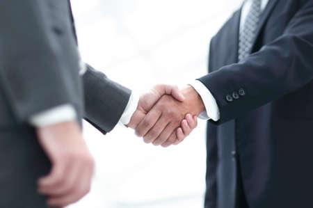 Photo pour Close up image of business handshake at meeting. - image libre de droit