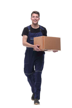 Photo for friendly worker with cardboard box stepping forward. isolated on white - Royalty Free Image