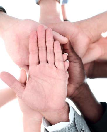 Photo pour Low angle view of fit people stacking hands - image libre de droit