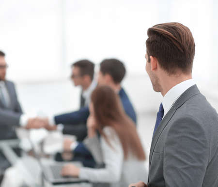 Photo for rear view. businessman looking at workplace - Royalty Free Image