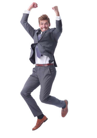 Photo pour in full growth. happy businessman showing his success - image libre de droit