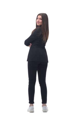 Photo pour rear view. young business woman looking forward - image libre de droit