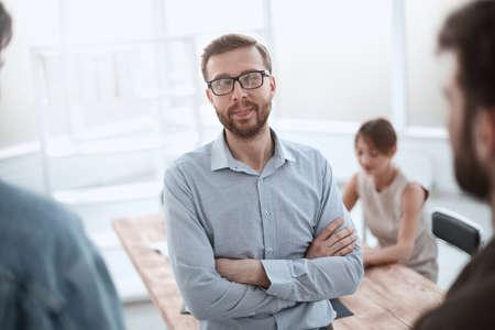 Photo pour successful business man standing in the office - image libre de droit