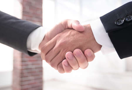 Photo pour closeup.handshake of business partners - image libre de droit