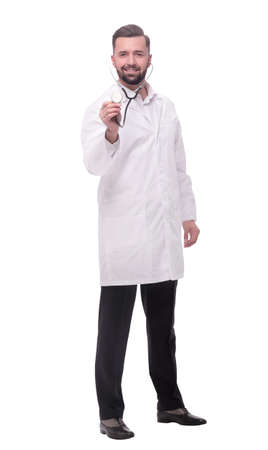 Photo pour in full growth. confident doctor therapist with a stethoscope - image libre de droit