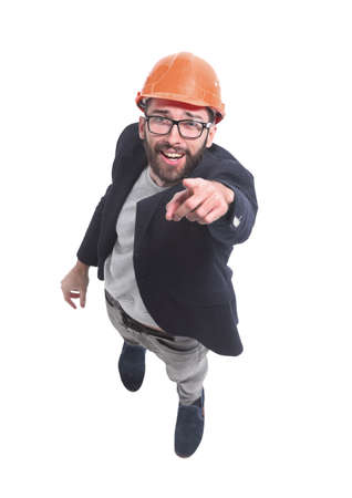 Photo pour top view. engineer architect in helmet pointing at you - image libre de droit
