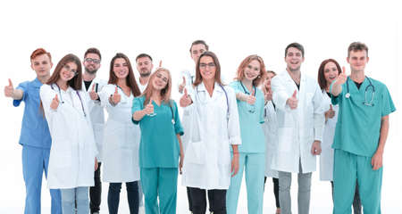 Photo pour top view. a group of smiling doctors looking at the camera. - image libre de droit