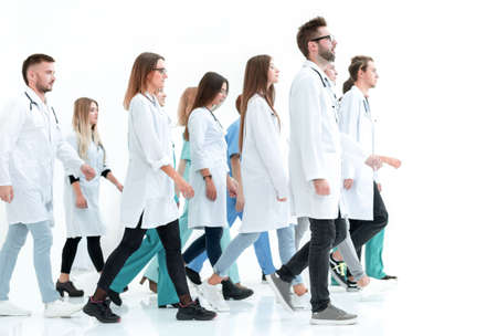 Photo pour group of medical interns looking at their leader - image libre de droit