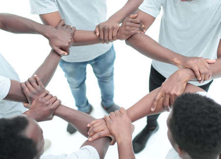 Photo pour close up. group of diverse guys standing in a circle . isolated on white background - image libre de droit