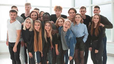 Photo pour group of happy friends standing together . close up. - image libre de droit