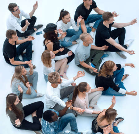 Photo for group of diverse young people meditate sitting on the floor. - Royalty Free Image