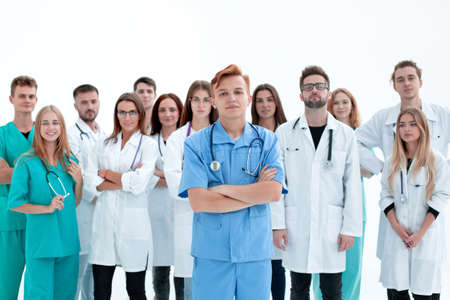 Photo pour young Intern doctor standing in front of his senior colleagues - image libre de droit