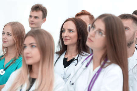 Photo pour close up. a group of medical professionals putting their hands together - image libre de droit