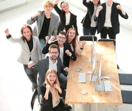 Foto de top view. happy business team showing their success - Imagen libre de derechos