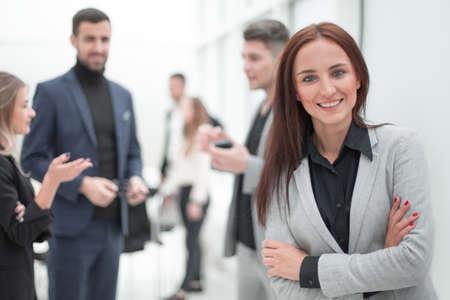 Foto de young business woman standing in modern office. - Imagen libre de derechos