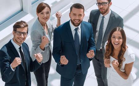 Photo pour top view.happy business team showing their success - image libre de droit