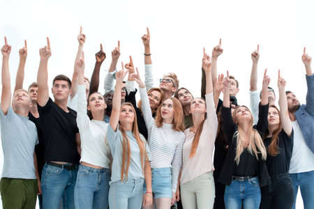 Photo pour group of serious young people where pointing up - image libre de droit