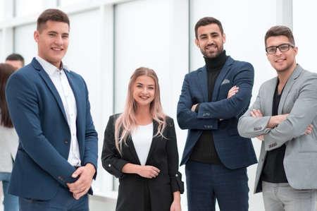 Foto de group of ambitious young employees standing in the office. - Imagen libre de derechos